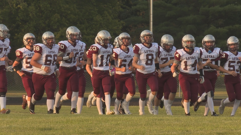 Loyal's Jace Prior (#10) runs out with the team before their season-opener against Abbotsford.
