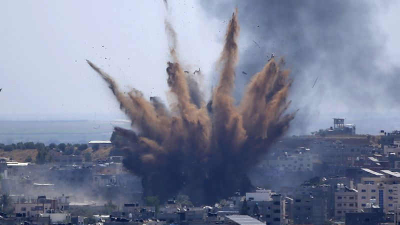 Smoke rises following Israeli airstrikes on a building in Gaza City, Thursday, May 13, 2021....