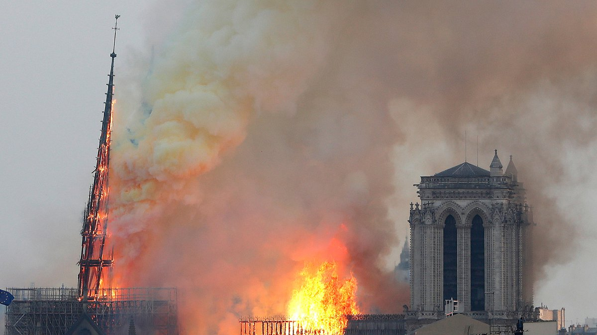 In this April 15, 2019, file photo, flames rise from Notre Dame cathedral as it burns in Paris.