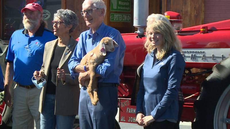 Wisconsin Gov. Tony Evers holding a goat in Amery, Wis. celebrating Wisconsin Agricultural...