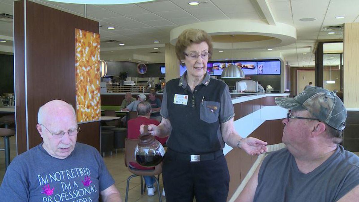 Grandma June serves coffee to some of her regulars at McDonald's on Hastings Way.