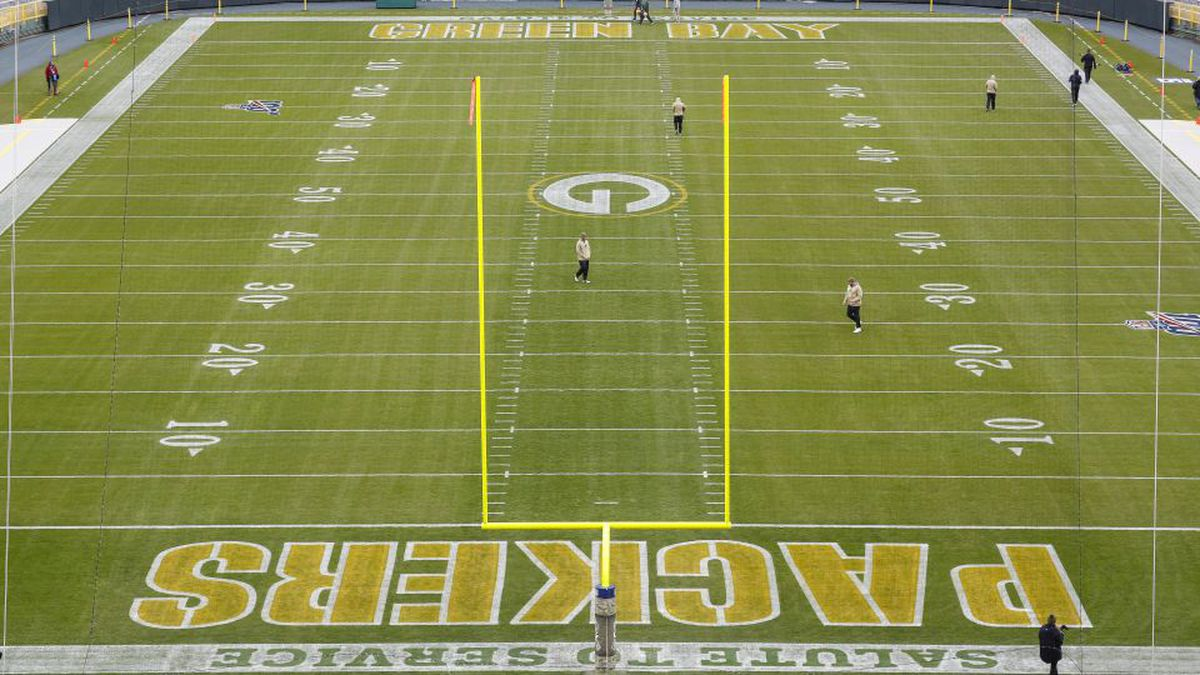 Workers prepare Lambeau Field before an NFL football game between the Green Bay Packers and Carolina Panthers Monday, Nov. 11, 2019, in Green Bay, Wis. (AP Photo/Matt Ludtke)
