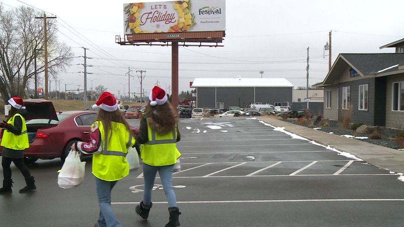 500 Christmas dinner meals being doled out Saturday afternoon to families in need at Hope...