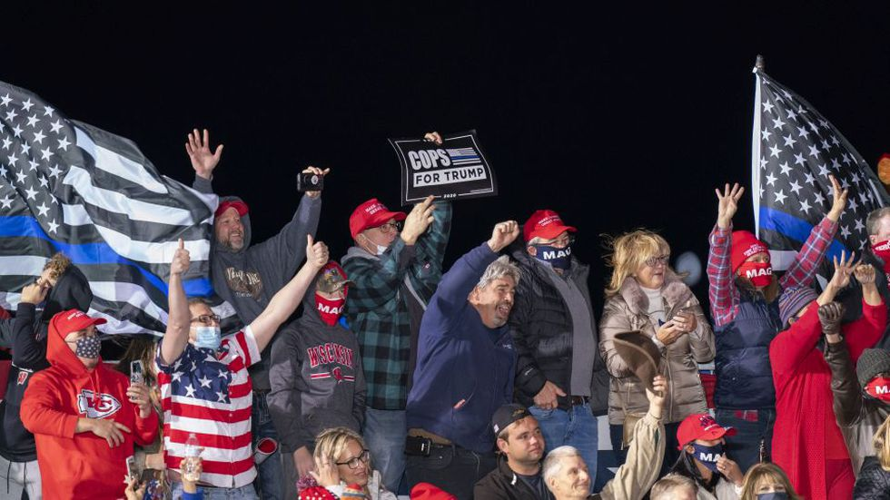 Supporters for President Donald Trump cheer during a campaign rally Saturday, Oct. 17, 2020, in...