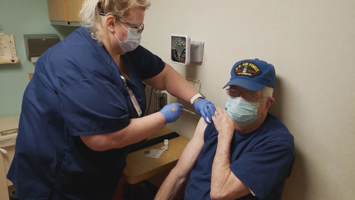 An SSM Health nurse administers a COVID-19 vaccine shot to Lemuel Ellis, one of the first...