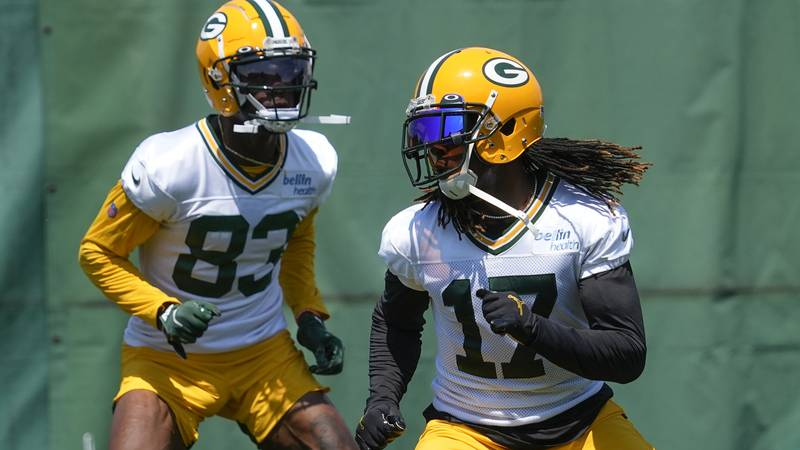 Green Bay Packers' Davante Adams and Marquez Valdes-Scantling run a drill during an NFL...