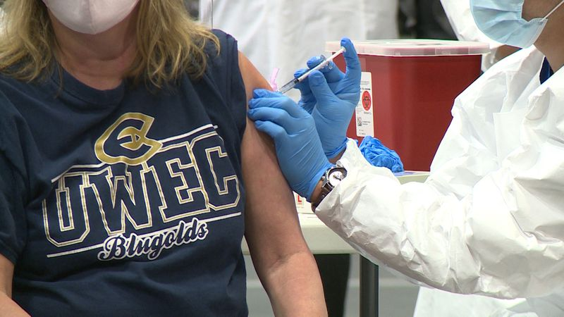 UWEC staff member, Sheri Snobl receiving her first dose of the COVID-19 vaccine at Zorn Arena,...