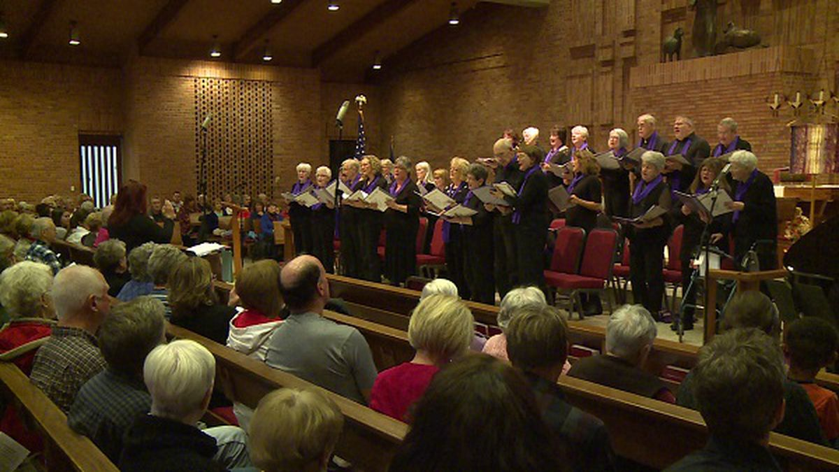 The Stand in the Light Memory Choir performs before a large audience at the Lutheran Church of the Good Shepherd in Eau Claire.