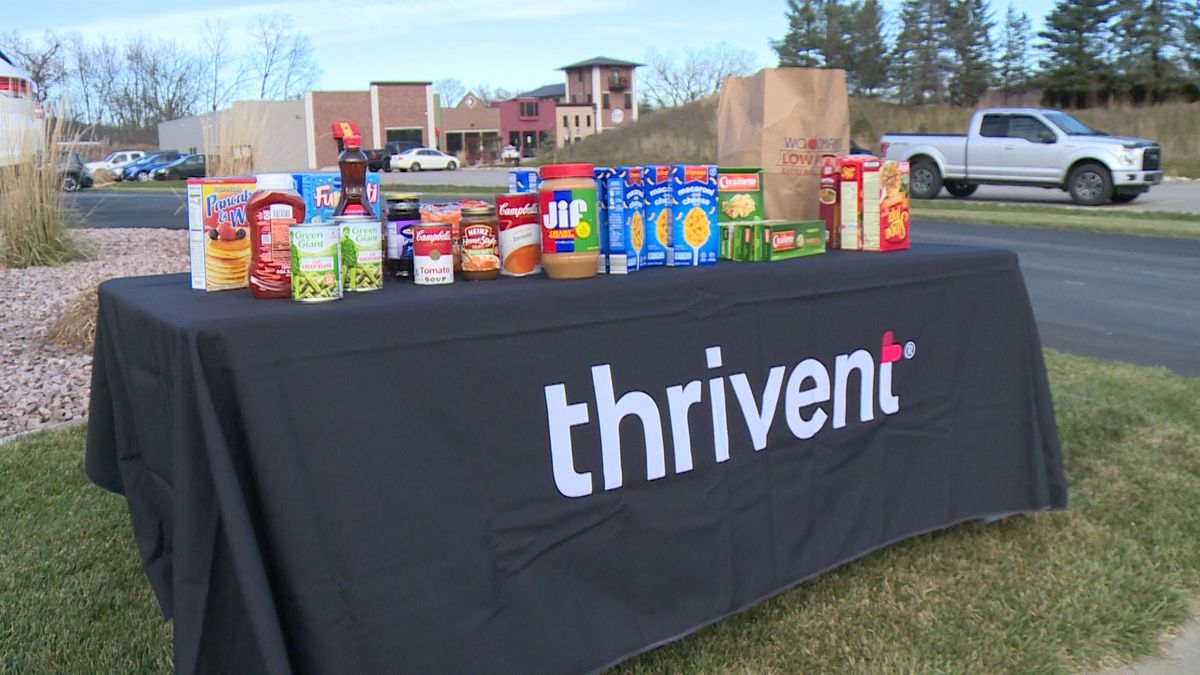 Community members dropped off food items outside Thrivent's office in Holmen.