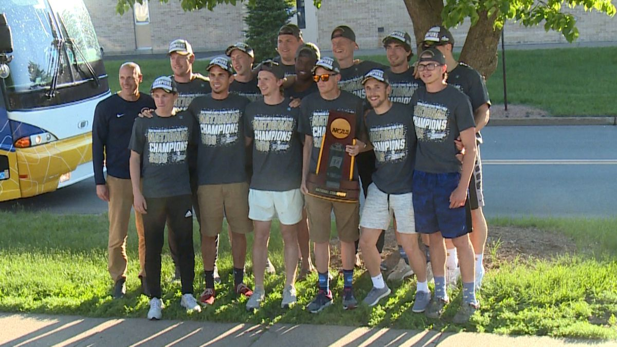 The UW-Eau Claire men's track and field team celebrate their national title.