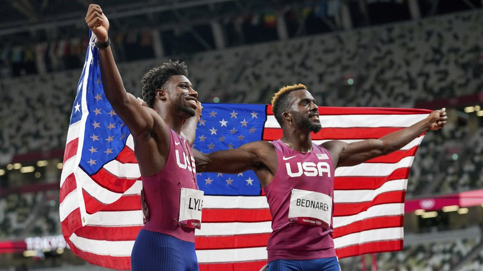 Kenneth Bednarek, right, of the United States, celebrates after winning the silver medal with...