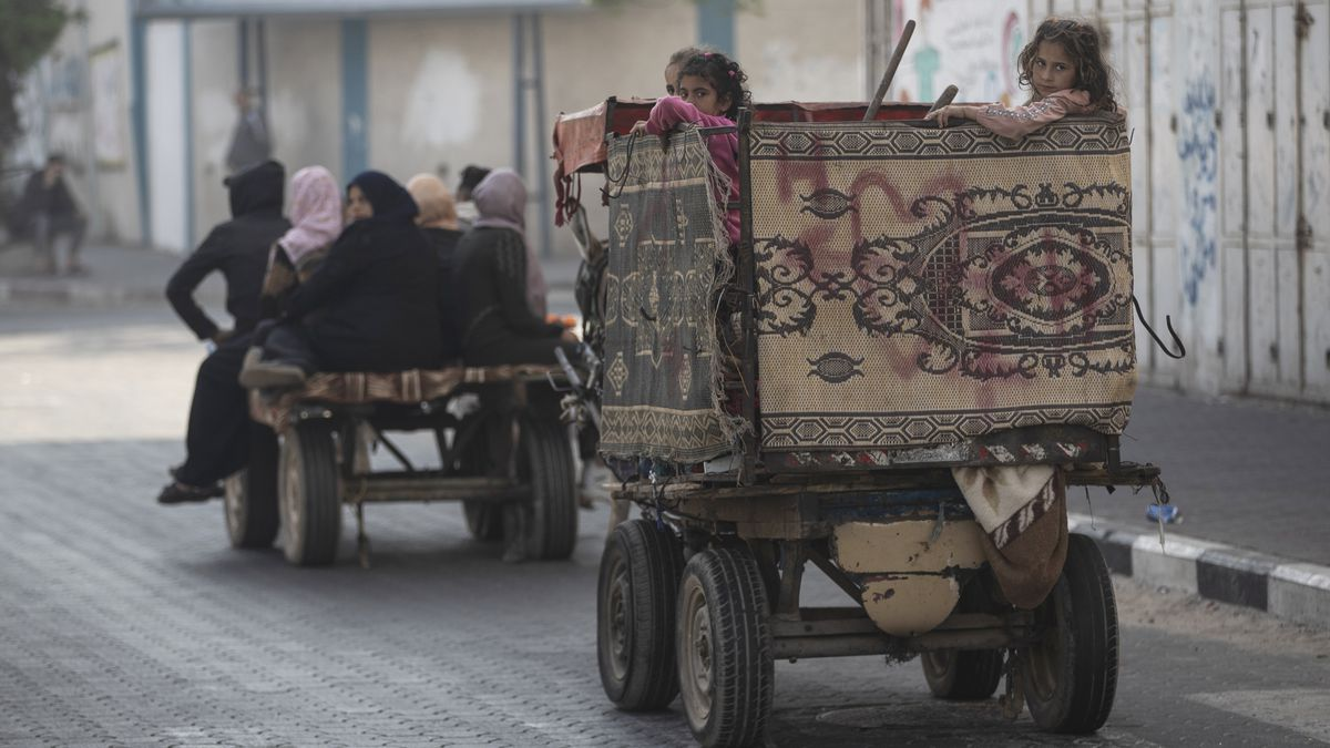 Palestinians flee their homes after overnight Israeli heavy missile strikes on their...