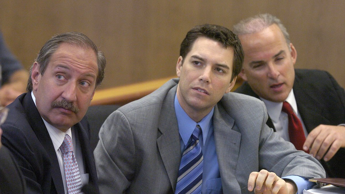 FILE - Scott Peterson, center, with defense attorneys Mark Geragos, left, and Pat Harris...