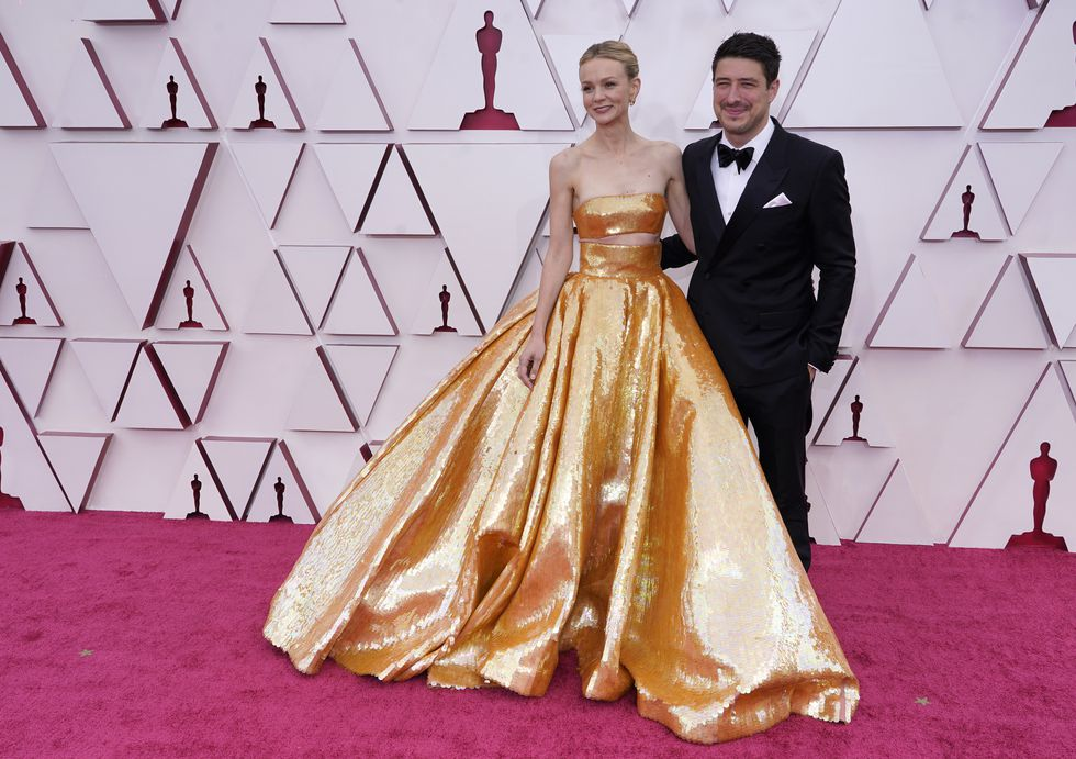 Carey Mulligan, left, and Marcus Mumford arrive at the Oscars on Sunday, April 25, 2021, at...