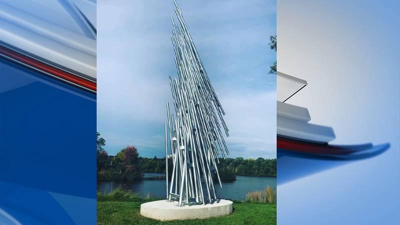 """Vertical Log Raft"" sculpture placed at RiverLife Park in Wausau"