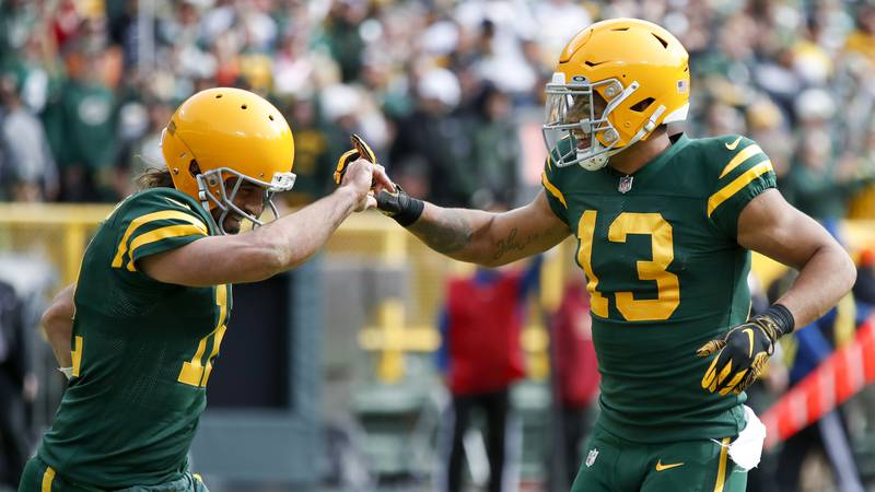 Green Bay Packers' Allen Lazard (13) celebrates his touchdown catch with Aaron Rodgers (12)...