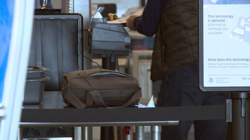 People go through TSA security at the Chippewa Valley Regional Airport.