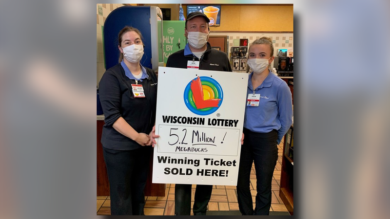 Employees at a Kwik Trip in Cottage Grove celebrate the $5.2 million jackpot ticket sold in...