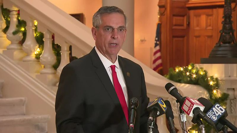 FILE - This photo taken from video shows Georgia Secretary of State Brad Raffensperger giving a...