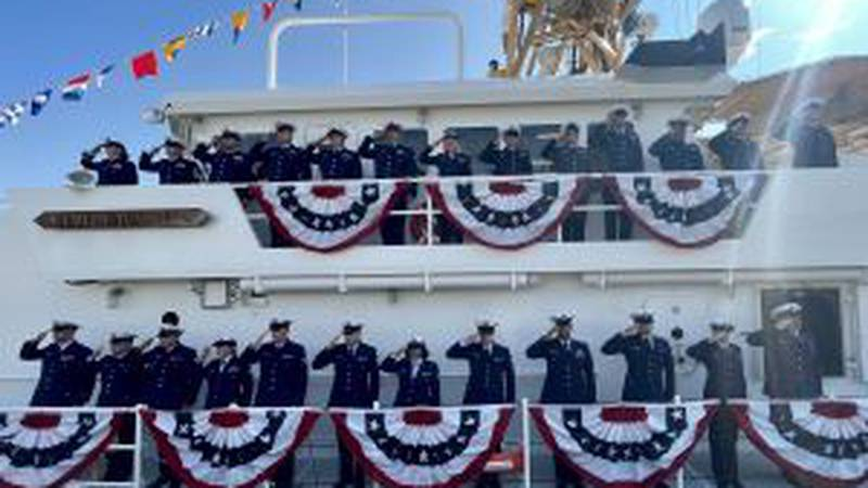 The crew of the USCGC Emlen Tunnell (WPC 1145) renders a hand salute during the commissioning...