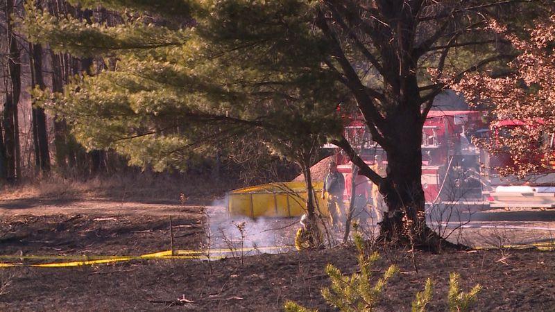 Crews putting out the final flames of a grass fire that erupted near Fairchild, Saturday...