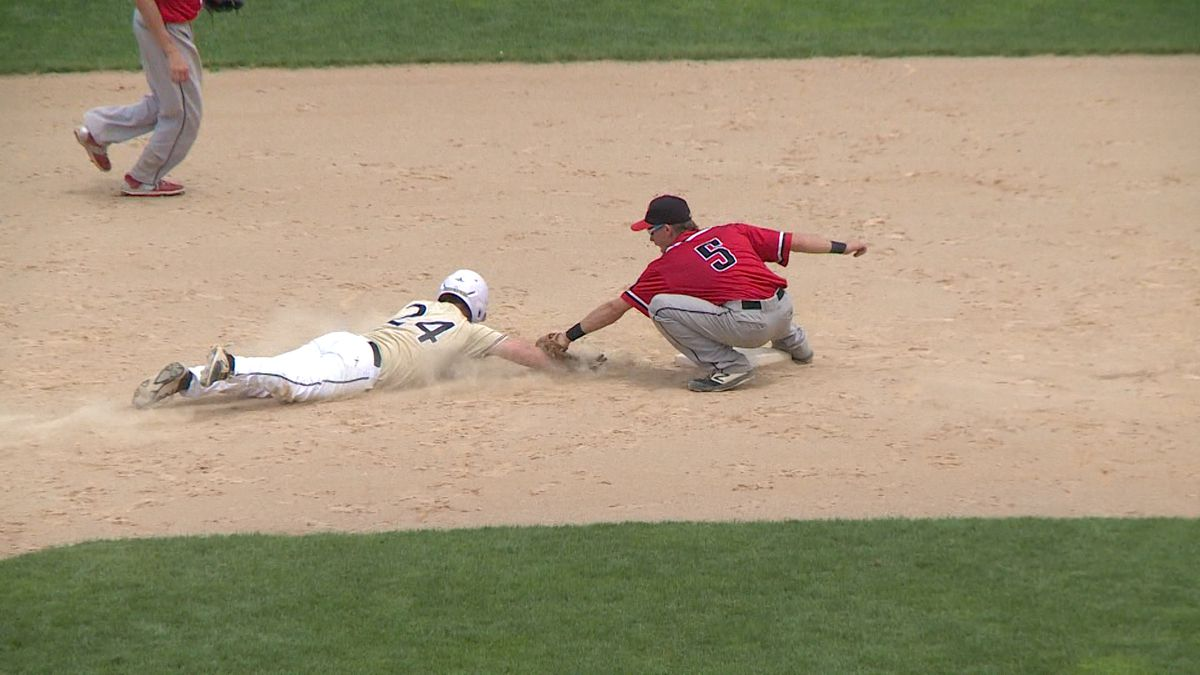 Eau Claire Pizza Hut's Joel Zachow tags the runner at 2nd after a perfect throw from catcher Joe Feck against Green Bay.
