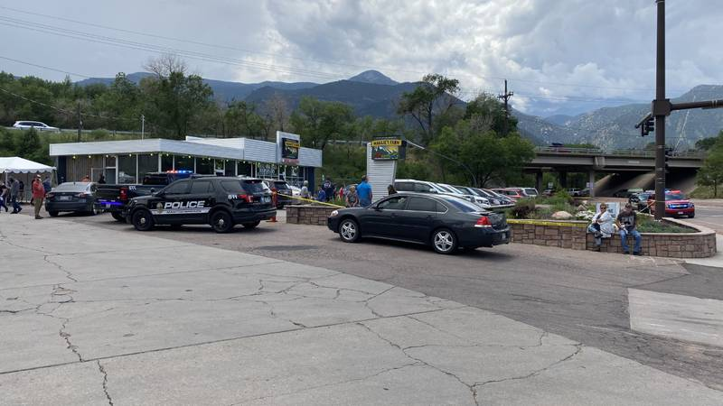 Crime tape and law enforcement can be seen around Maggie's Farm on the outskirts of Manitou...