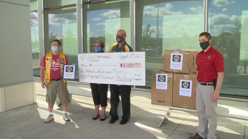 A check was donated to healthcare workers to use for PPE.