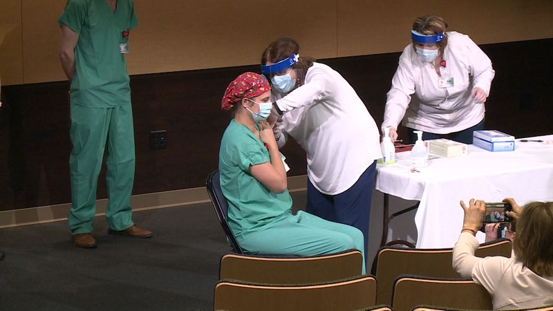 Five Gundersen employees were chosen to receive the vaccine first because they're at higher...
