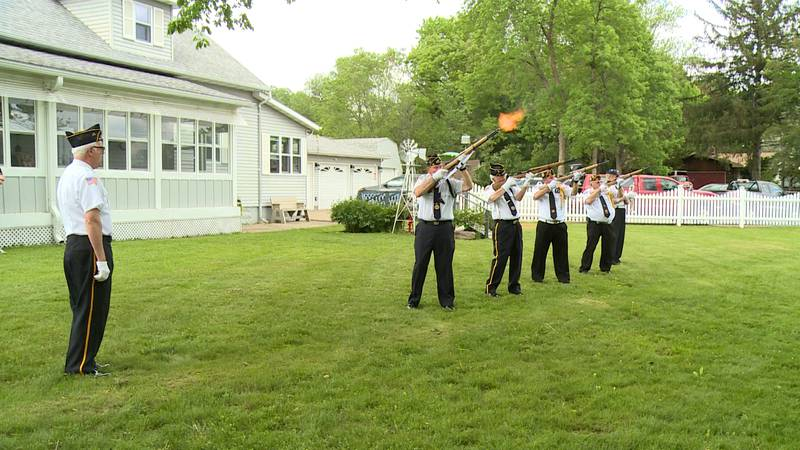 Military honors performed for Buzz.