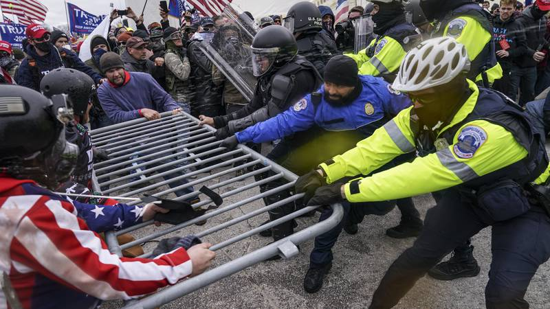In this Jan. 6, 2021, file photo violent insurrectionists loyal to President Donald Trump hold...