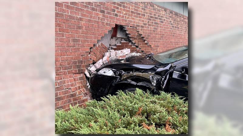 Madison Fire Dept. responds after a vehicle hits a building in the 2200 block of Independence...