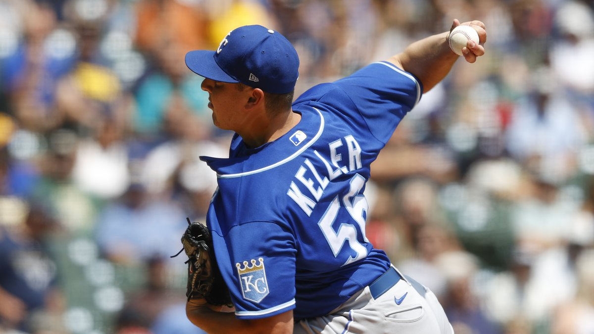 Kansas City Royals starting pitcher Brad Keller throws to the Milwaukee Brewers during the...