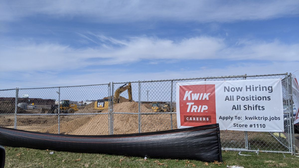 A backhoe digs dirt as construction is underway on a new Kwik Trip on Eau Claire's southeast...