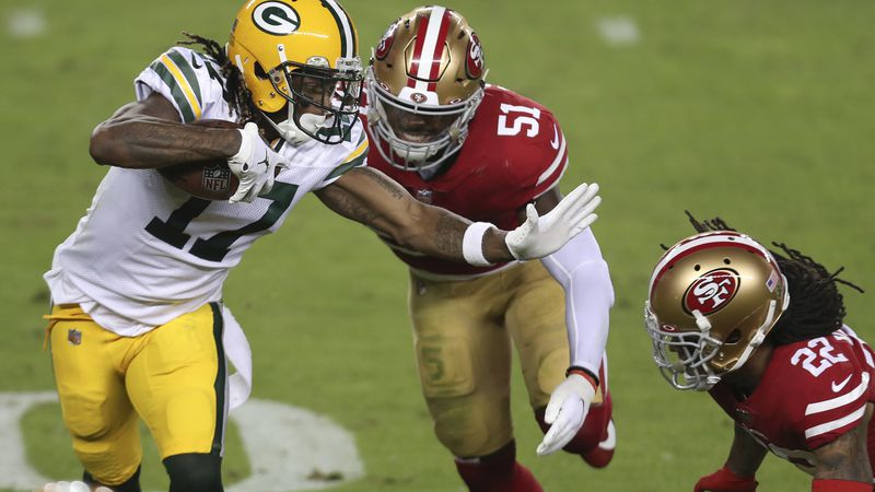 Green Bay Packers wide receiver Davante Adams (17) runs against San Francisco 49ers linebacker...