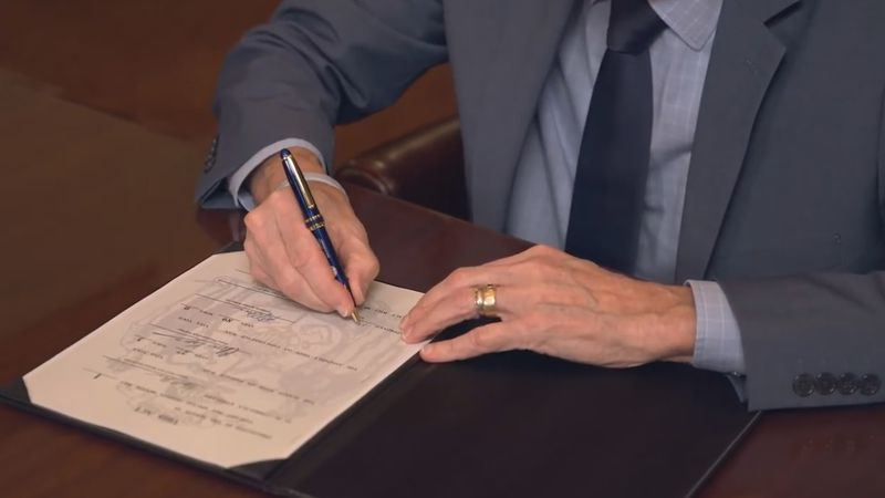 Gov. Tony Evers signs legislation authorizing upgrades to the state unemployment system on Feb....