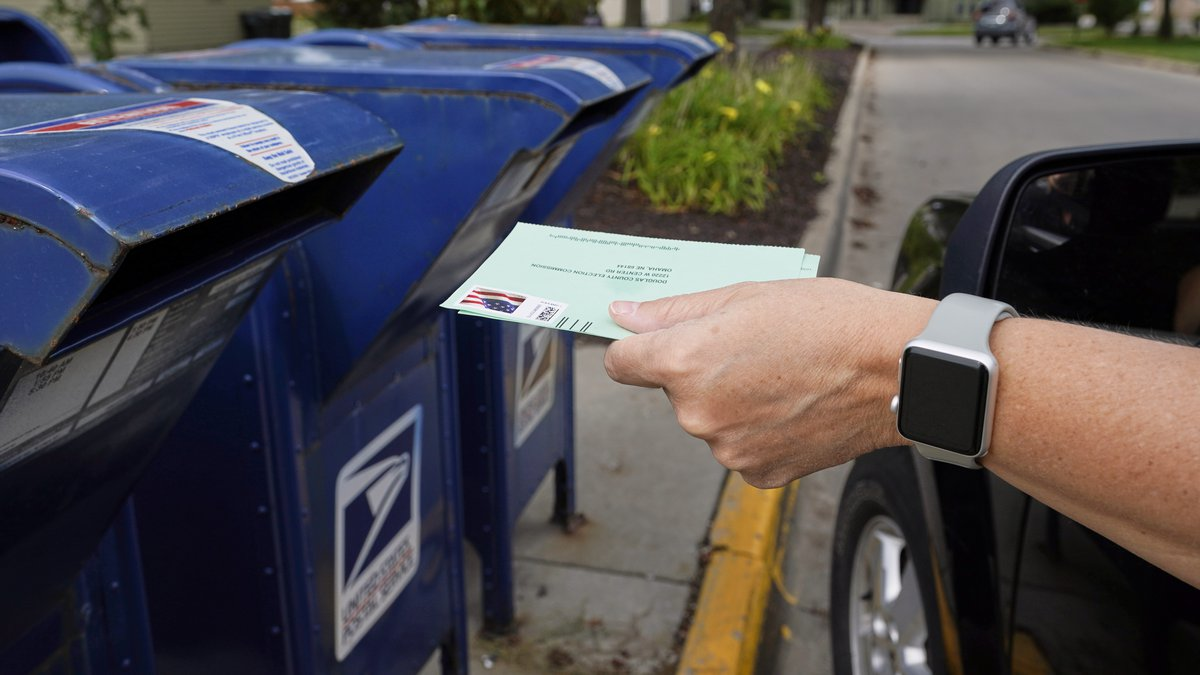 FILE - In this Tuesday, Aug. 18, 2020, file photo, a person drops applications for...