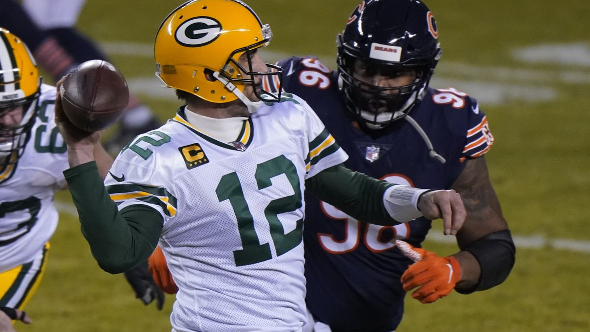 Green Bay Packers' Aaron Rodgers throws a pass during the second half of an NFL football game...