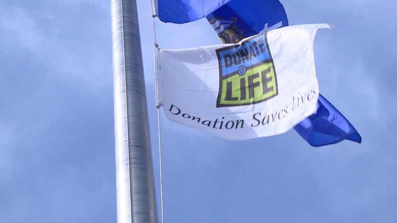 Donate Life flag raised in Eau Claire to bring awareness to the need of donors.