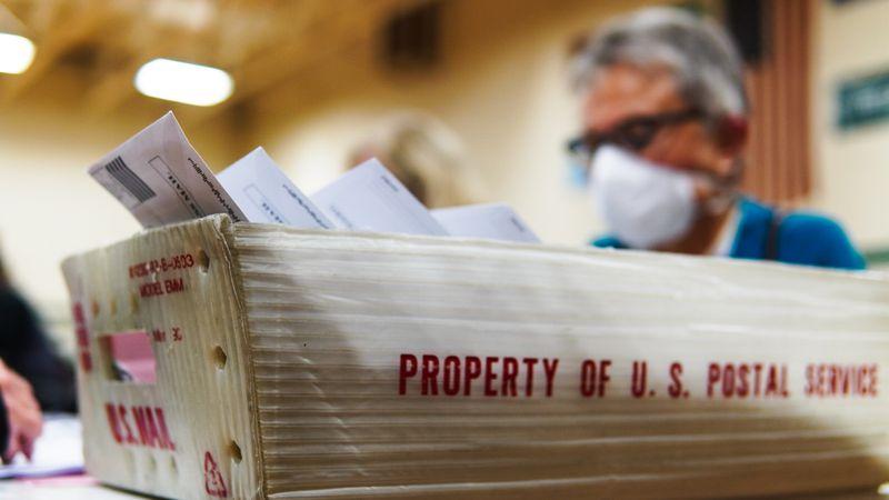 Poll worker counts absentee ballots