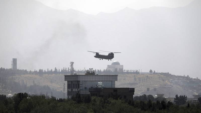 A U.S. Chinook helicopter flies over the U.S. Embassy in Kabul, Afghanistan, Sunday, Aug. 15,...