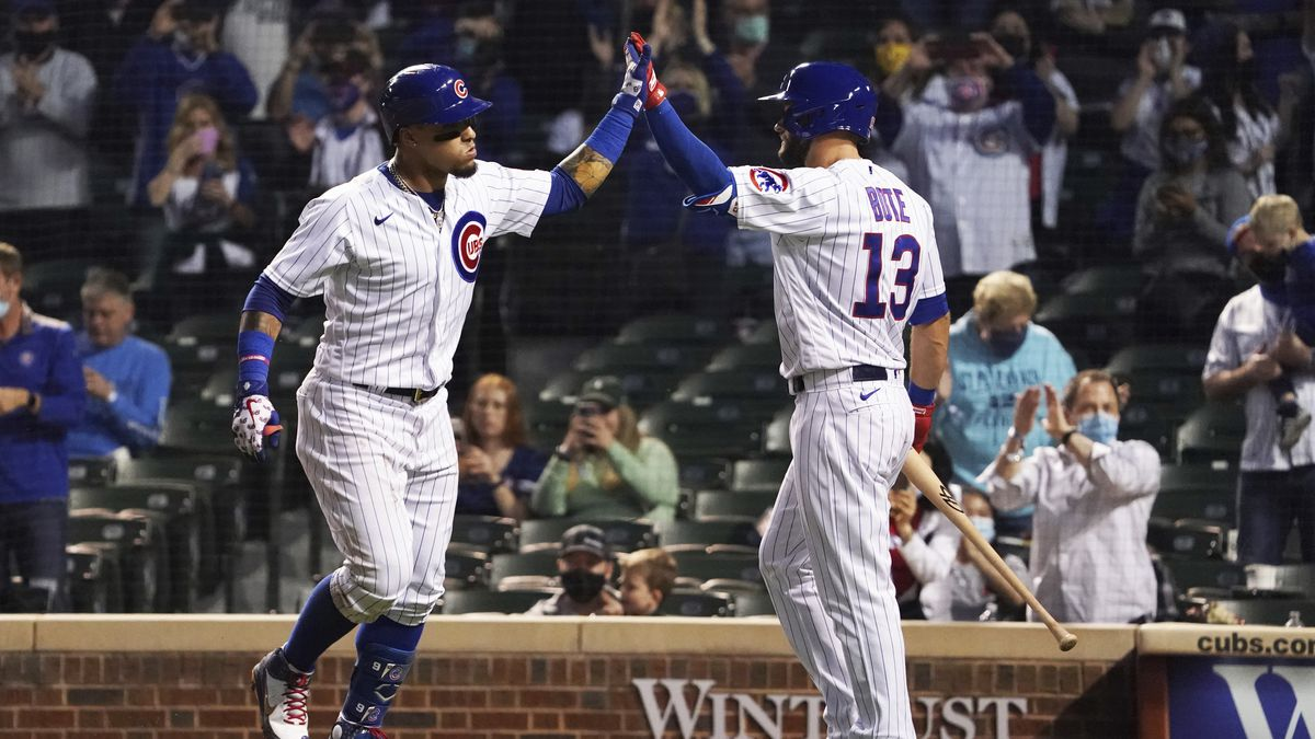 Chicago Cubs Javier Baez, left, is greeted by David Bote, right,  after hitting a home run...