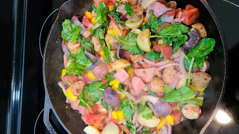 Potatoes with sausage, kale and peppers