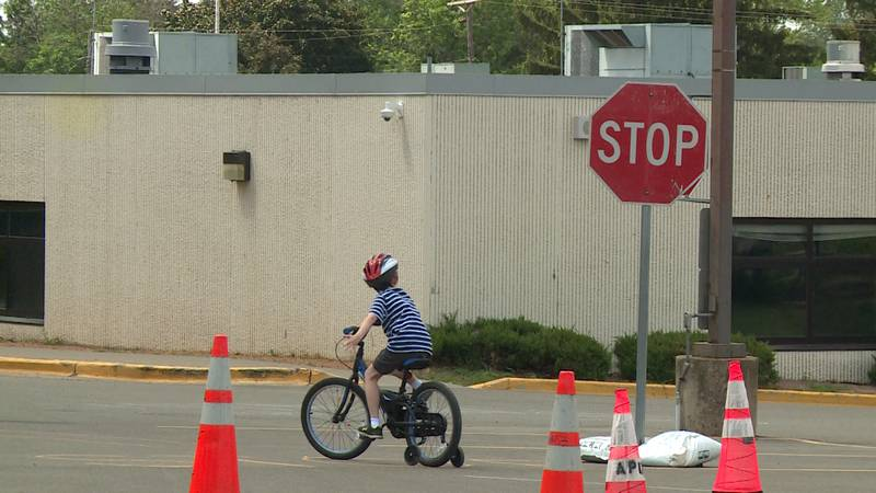 A kid riding his bike at the Altoona bike rodeo in Altoona, Wis.