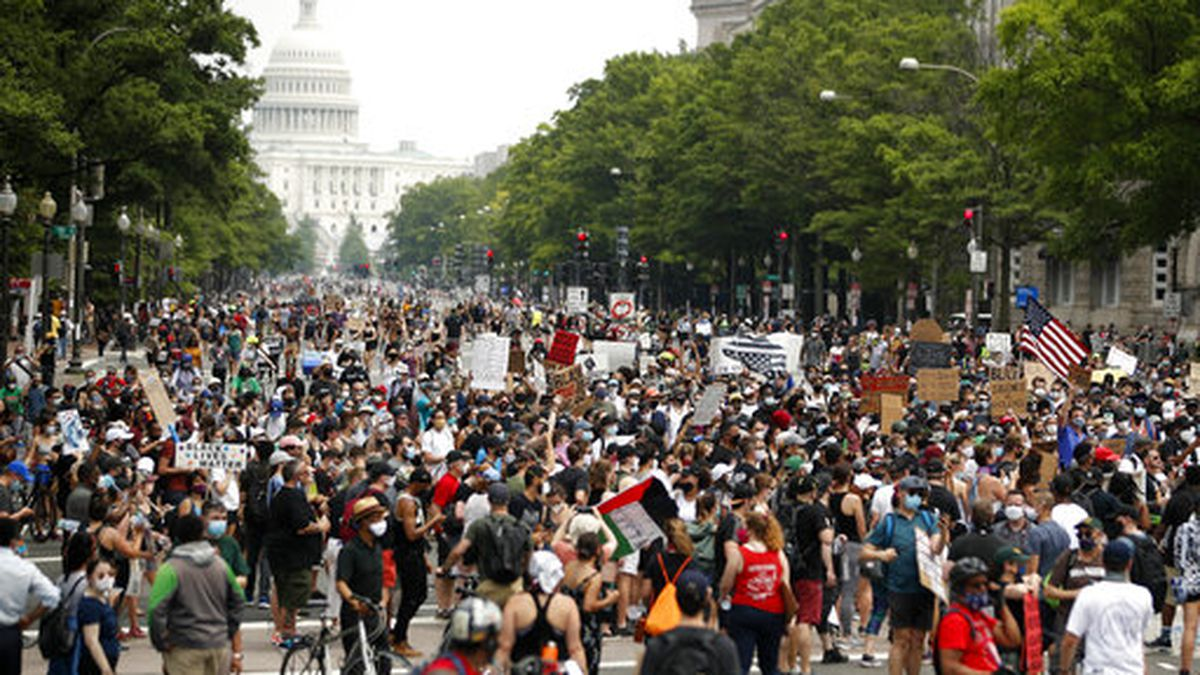 Demonstrators walk on Pennsylvania Avenue as they protest, Saturday, June 6, 2020, in Washington, over the death of George Floyd, a black man who was in police custody in Minneapolis. Floyd died after being restrained by Minneapolis police officers. (AP Photo/Andrew Harnik)