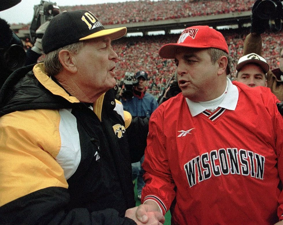 FILE - In this Nov. 8, 1997, file photo, Wisconsin coach Barry Alvarez, right, is congratulated...