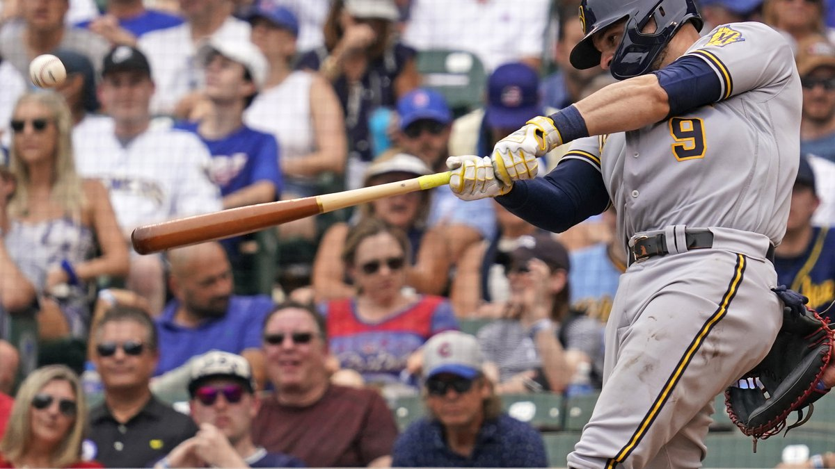 Milwaukee Brewers' Manny Pina hits a grand slam during the fifth inning of a baseball game...
