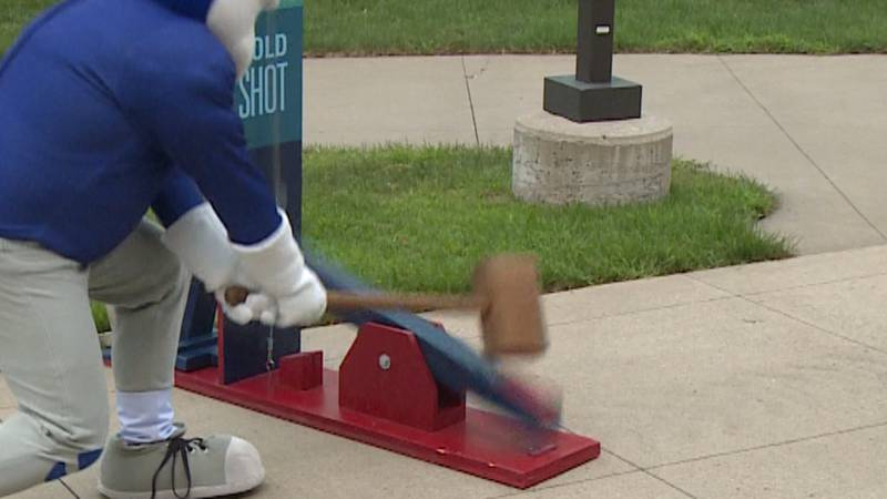 "The UW-Stout mascot hits a high striker to ""Smash COVID"" in Menomonie, Wis."