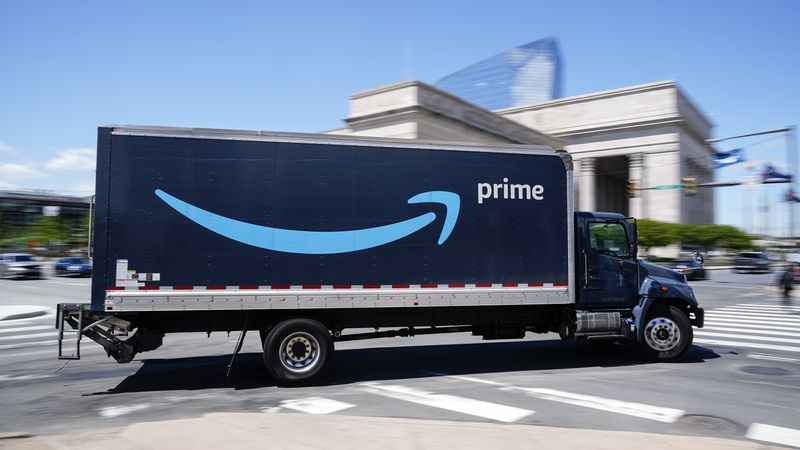 An Amazon truck drives in in Philadelphia, Friday, April 30, 2021.  Amazon is seeking to hire...