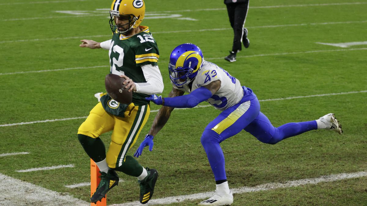 Green Bay Packers quarterback Aaron Rodgers scores on a one-yard touchdown run past Los Angeles...
